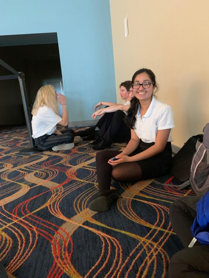 Ruhee Nemwarkar '22 smiles as she sits and waits for her event to begin.