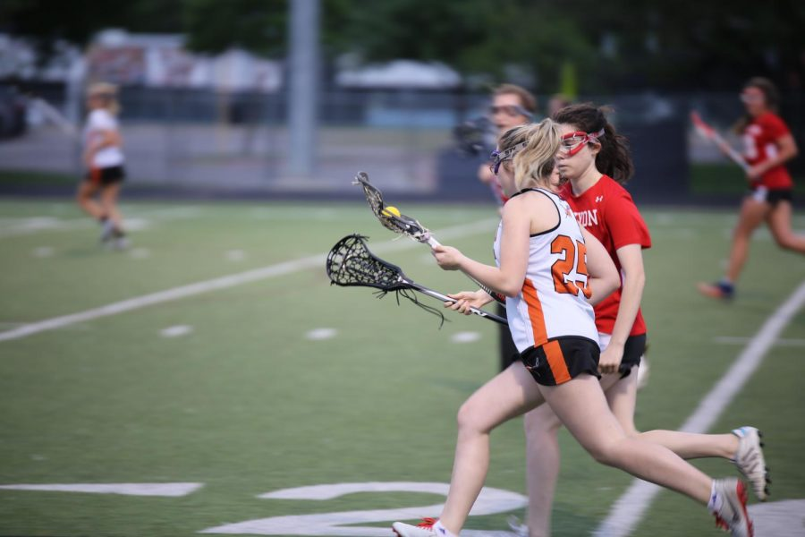 Megan Moravec '21 attempts to dodge the enemy defenders to score.