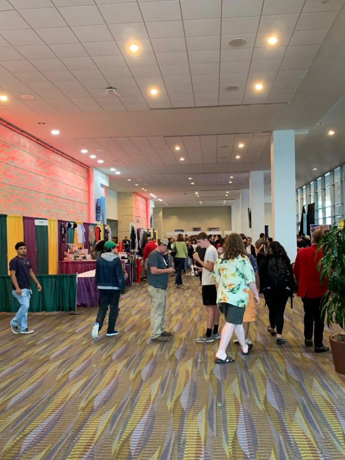 Students walk around inside the American Bank Center to learn more about programs offered by businesses and colleges.