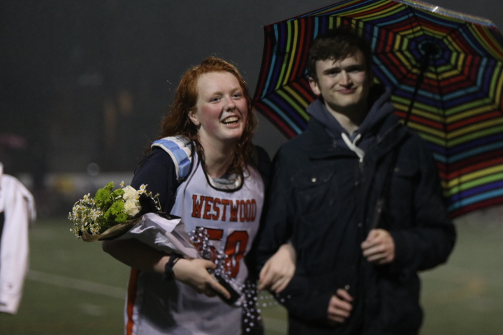 Catherine Wiesehuegel '19 laughs as she is honored on the field.