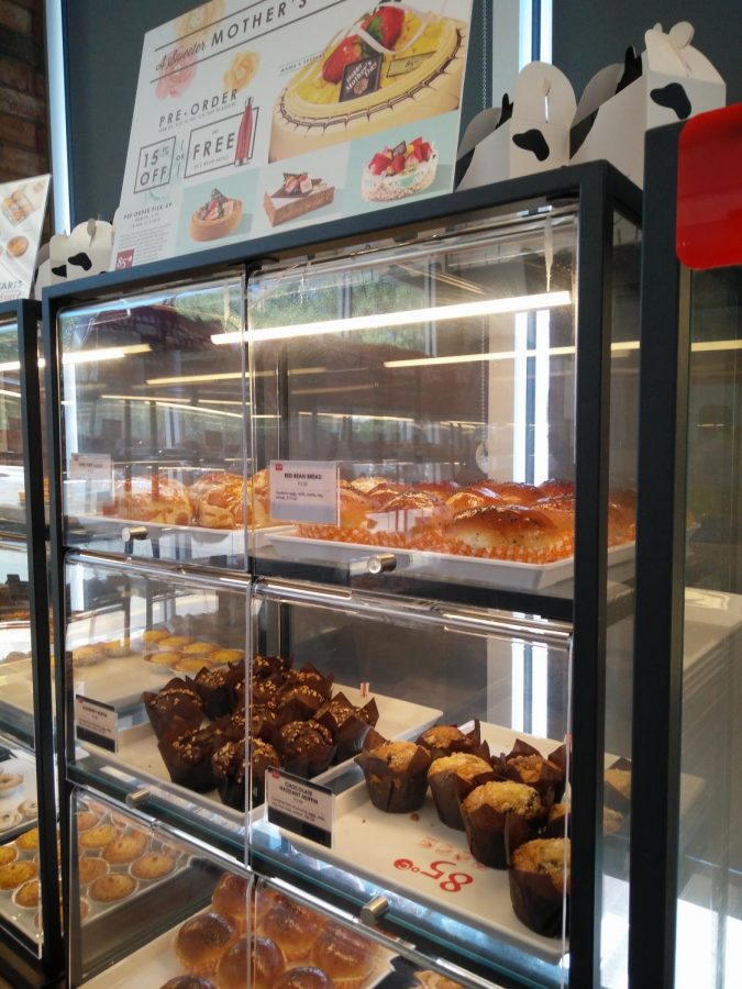 Cases inside the bakery full of different treats.