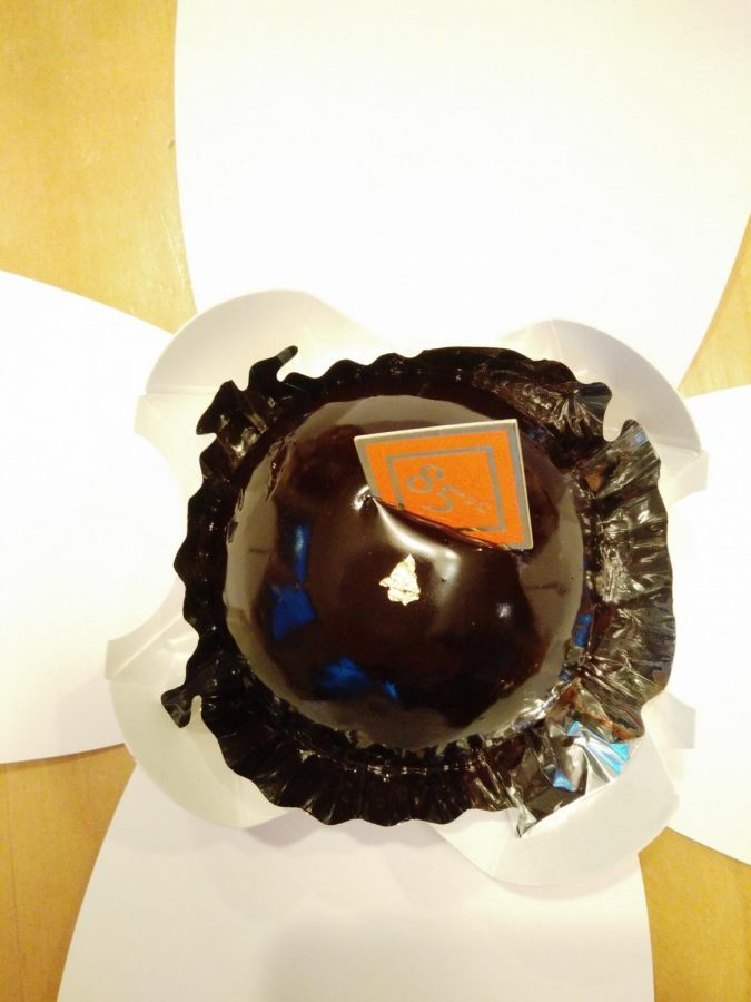 The Chocolate Pearl has a smooth chocolate mirror glaze with a little gold decoration on top.