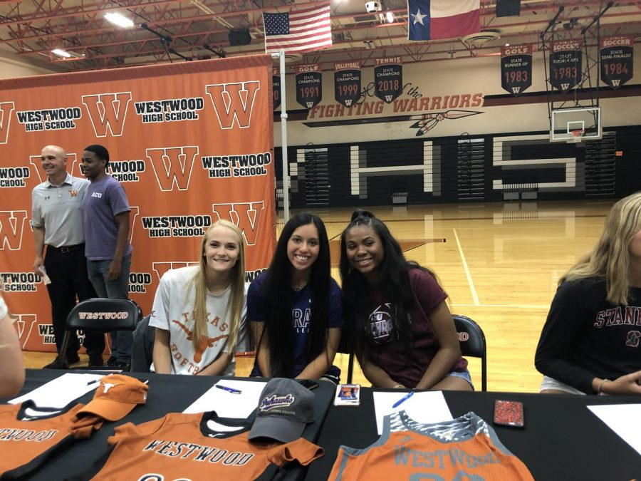 Seniors Alyssa Popelka, Gabby Garcia, and Oni Boodoo pose before signing.