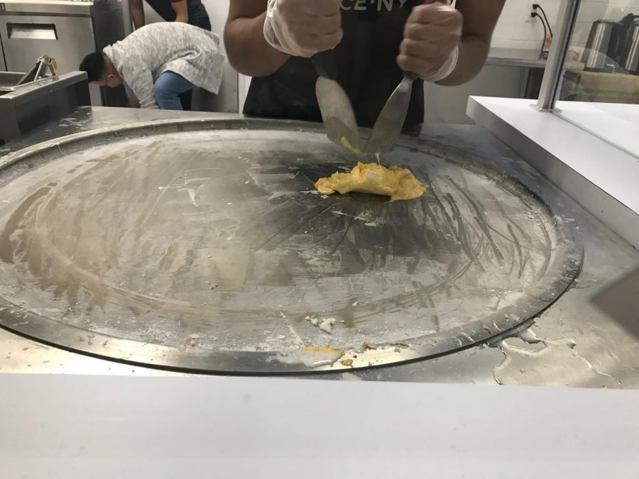 The employees mash the milk and mix in together and roll them out afterwards.