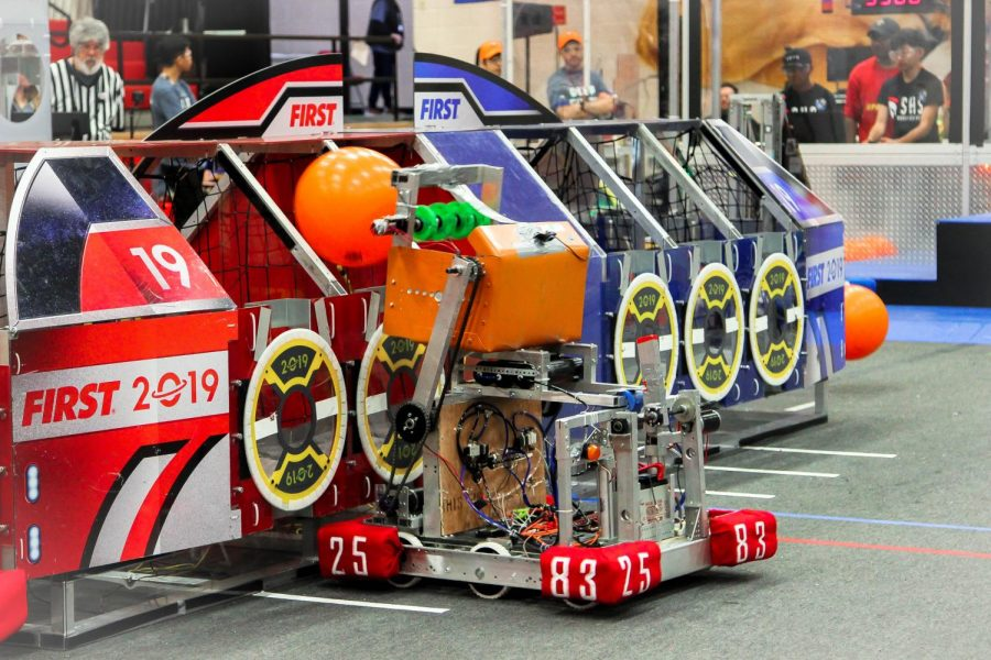 The Robowarriors robot drops a ball into a box in one of the competitions events.
