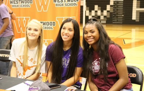 Seniors Alyssa Popelka, Gabby Garcia, and Oni Boodoo pose together during signing.