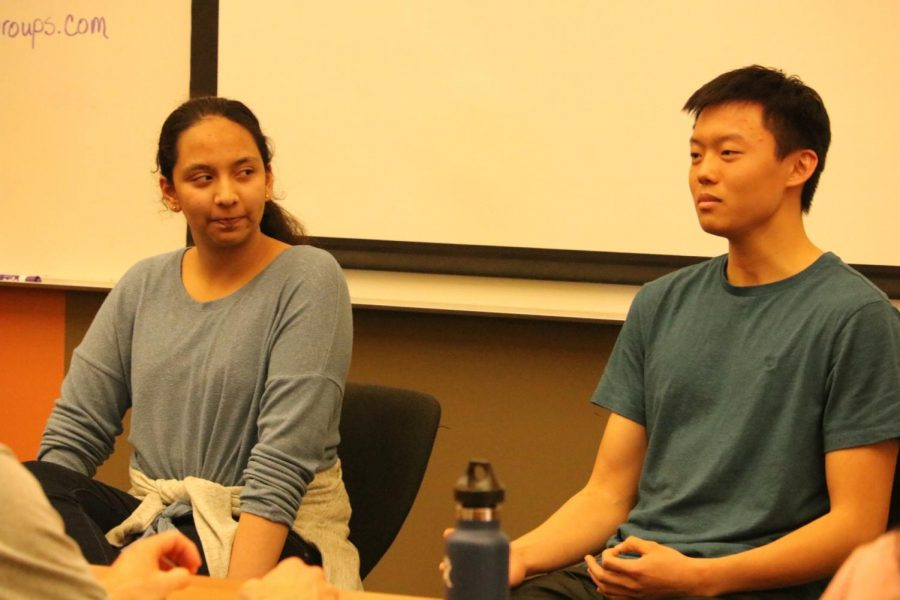 Harini Venkoba Rao '20 listens as Glen Liu '21 tells parents how he knows when he feels anxious.