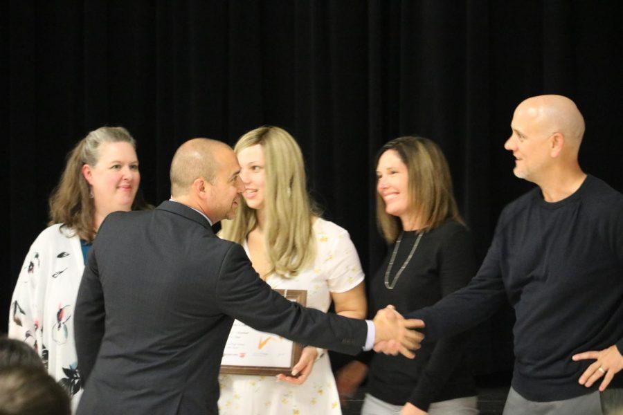 Mr. Mario Acosta congratulates Amanda Klein '19 and her family.