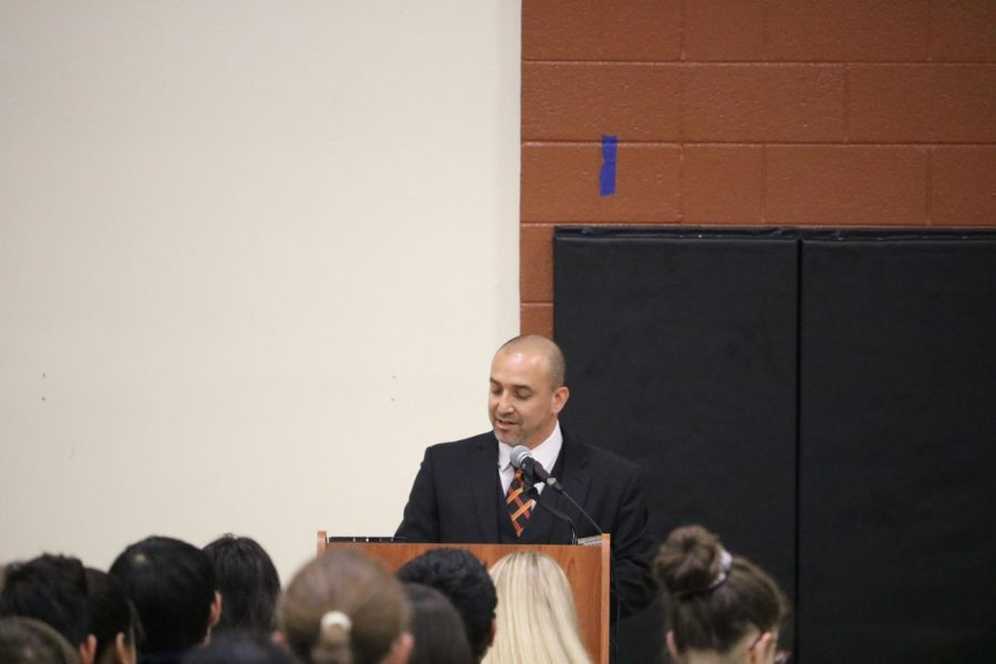 Principal Mario Acosta addresses everyone present and welcomes them to the ceremony.