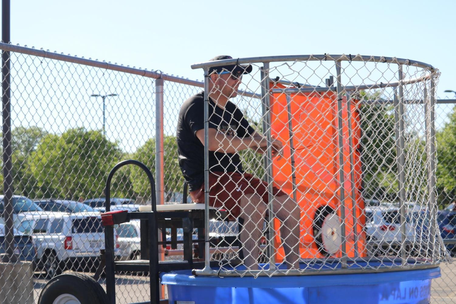 Principal+Mario+Acosta+sits+in+the+dunk+tank+as+students+attempt+to+dunk+him.+