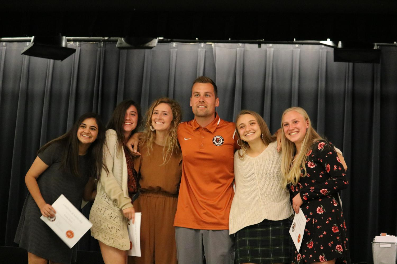 Coach+Malcolm+Framjee+presents+soccer+awards+to+seniors+Sonali+Dayal%2C+Maddison+Larrea%2C+Marisa+Rech%2C+Claire+Tinker%2C+and+Christie+French.
