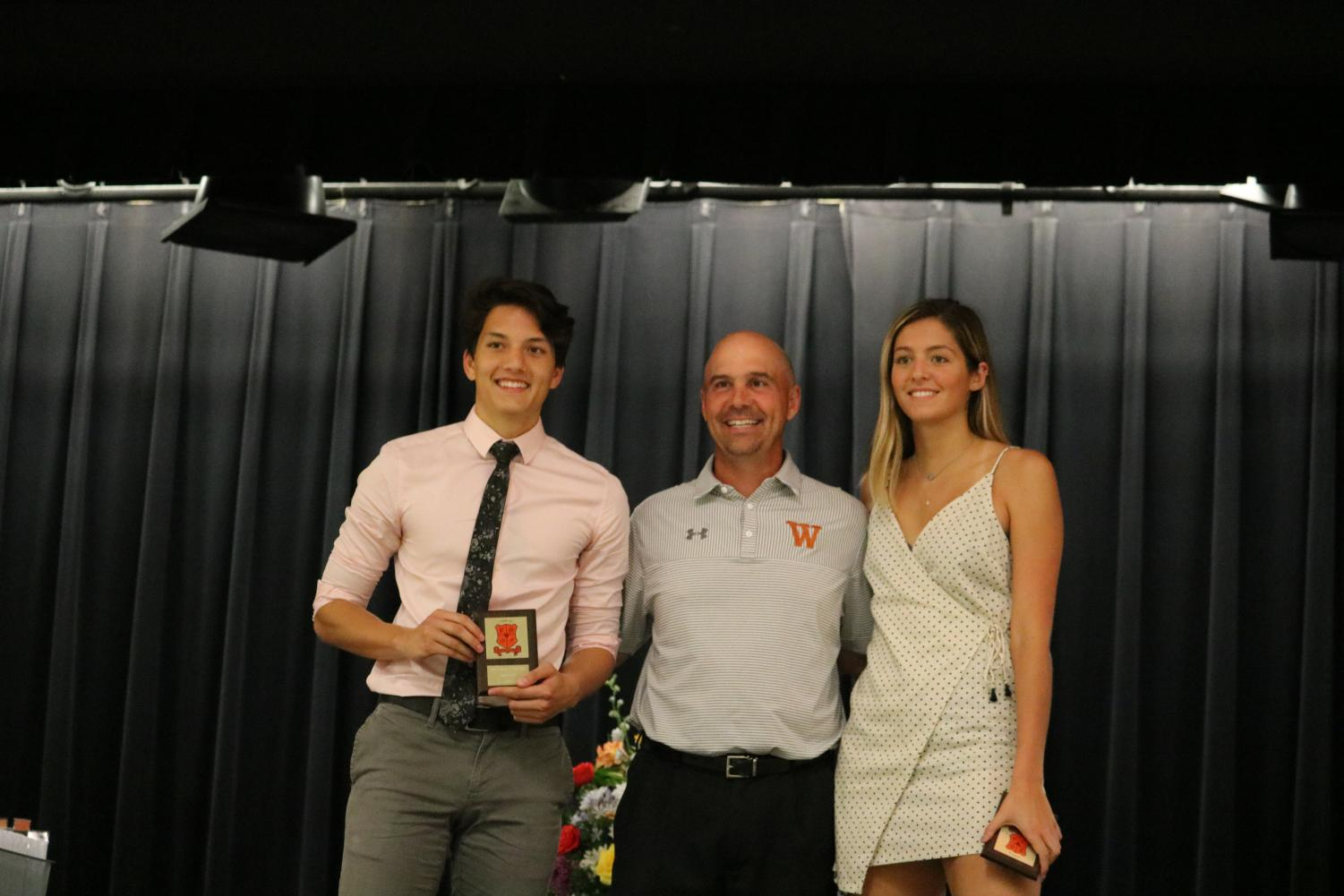 Coach+Anthony+Wood+presents+the+male+and+female+athlete+of+the+year+award+to+seniors+Jack+Elliott+and+Maddi+Kriz.