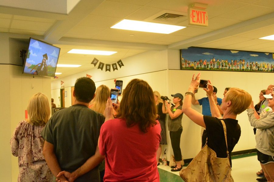 Parents watch as seniors announce their college plans.