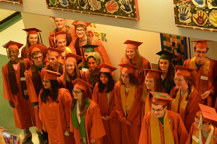 Seniors gather for a photo after walking around Canyon Creek Elementary.
