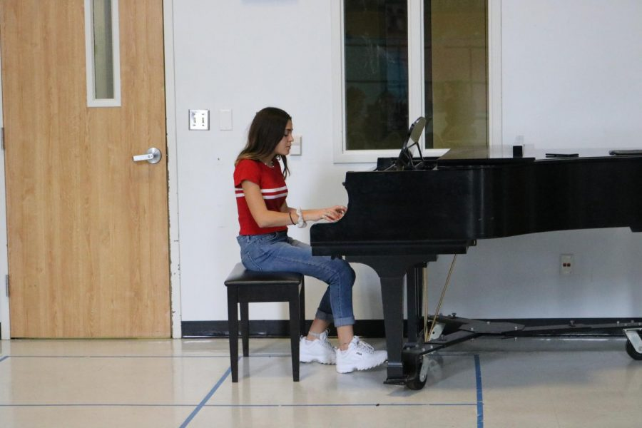 Sophia Cobert 21 plays piano as she sings Watch by Billie Eilish.