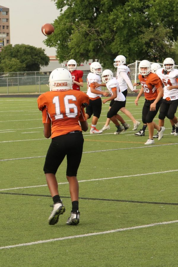 Demar Flemings '21 watches the ball and prepares to make his catch.