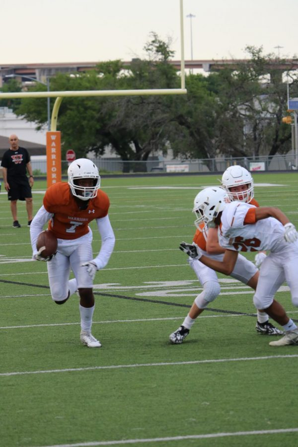 Julian Deberry 21 runs upfield after catching the short pass while Samit Umatiya 20 tries to get to him.
