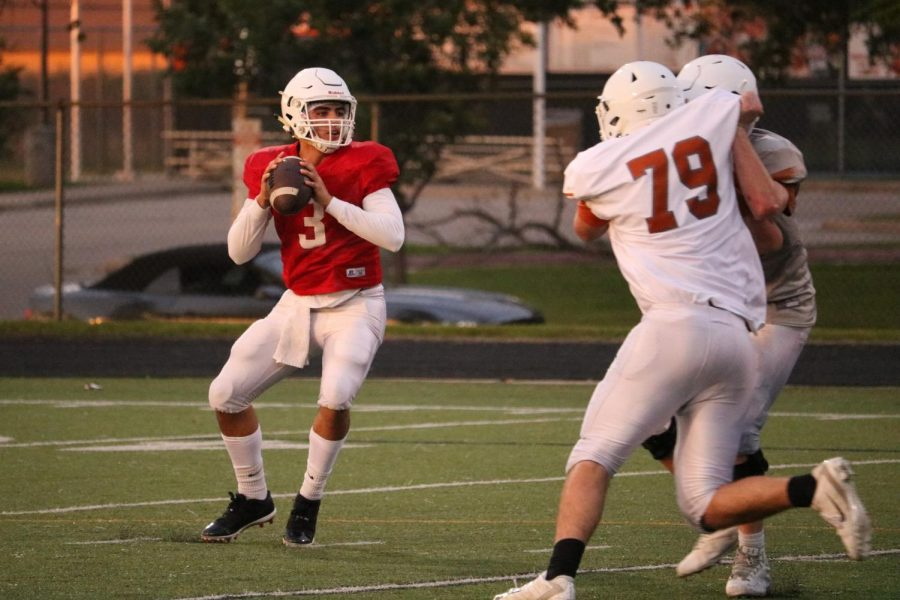 RJ Martinez 21 stands in the pocket as Mason Pfeifer 20 tries to get to him.