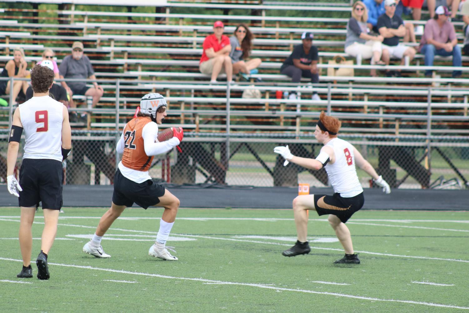 Drew+Goodall+%2721+gets+an+interception+and+tries+to+get+past+the+receiver.