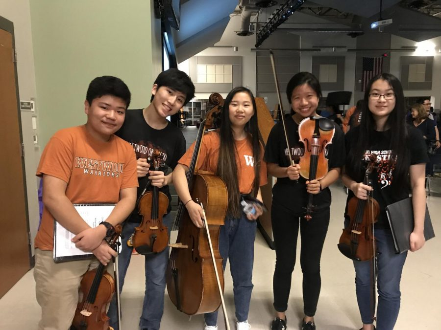 Sophomores Elliot Kim, Edward Seo, Erin Zhang, Anna Chiu, and Hannah Liu pose together after their orchestra concert.