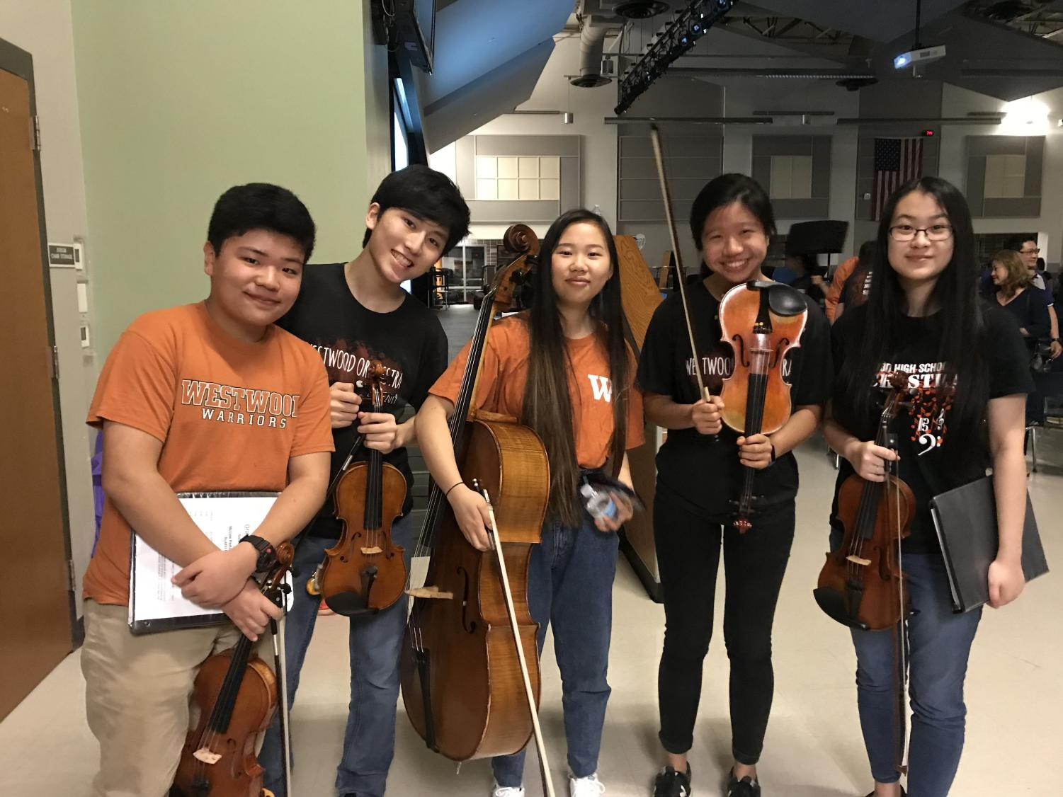 Sophomores+Elliot+Kim%2C+Edward+Seo%2C+Erin+Zhang%2C+Anna+Chiu%2C+and+Hannah+Liu+pose+together+after+their+orchestra+concert.+