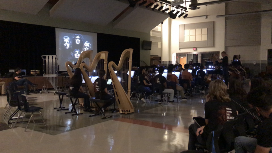 Symphony Orchestra plays Bohemian Rhapsody while the video is projected in the background.