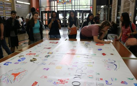 Seniors Sign College Banner