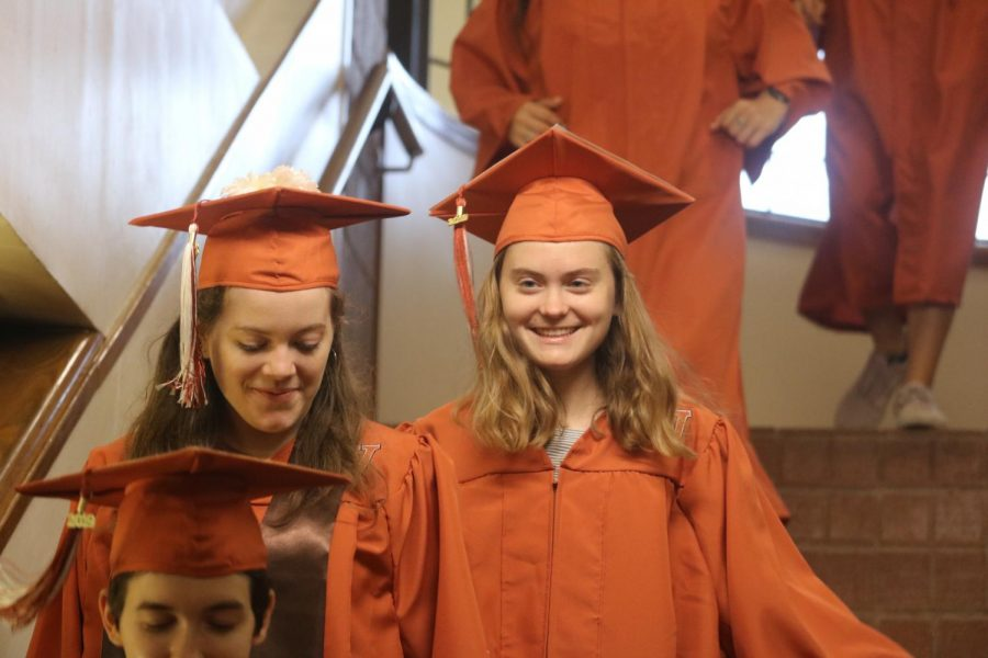 Seniors Lizzie Deal and Seren Lind walk through Canyon Vista on their last day of school.