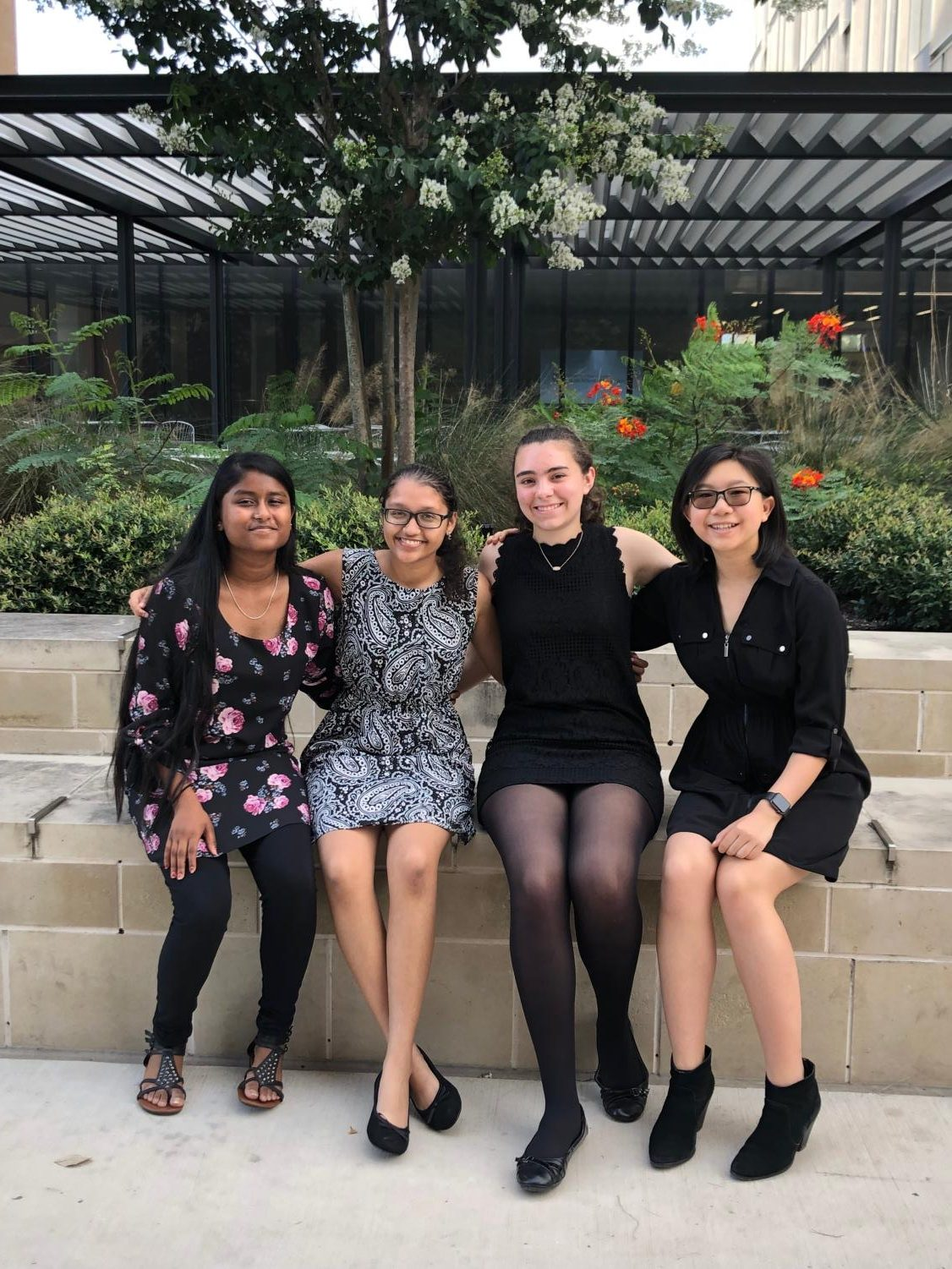 Students Linsy Stephen '22, Srilekha Cherukuvada '21, Abigail Dewhirst '21, and Emily Tran '21 pose for a picture outside of the music building after performing.