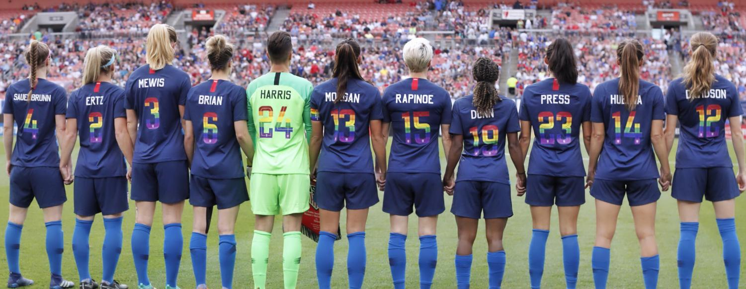 The U.S. women's national team shows off their pride jerseys before a friendly against China on June 12, 2018.