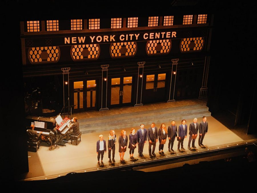 The cast of Working: A musical stands on the stage before the final curtain closes.