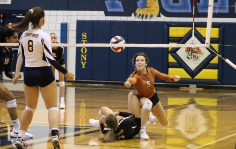 "Melani Helms '22 dives for the ball at the JV Orange volleyball game against Stony Point. While they lost the point, the Warriors won the game. ""We really started to work together as a ream, and we were a lot more aggressive,"" Helms said."