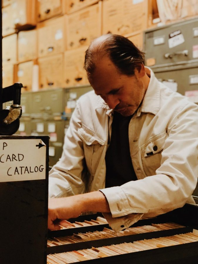 Mr. Roth, the archivist, examines news clippings in the New York Times archival room known as the morgue.