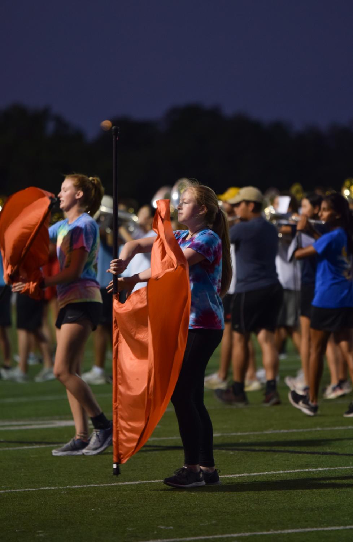 Lexie+Robison+%2721+spins+her+flag.