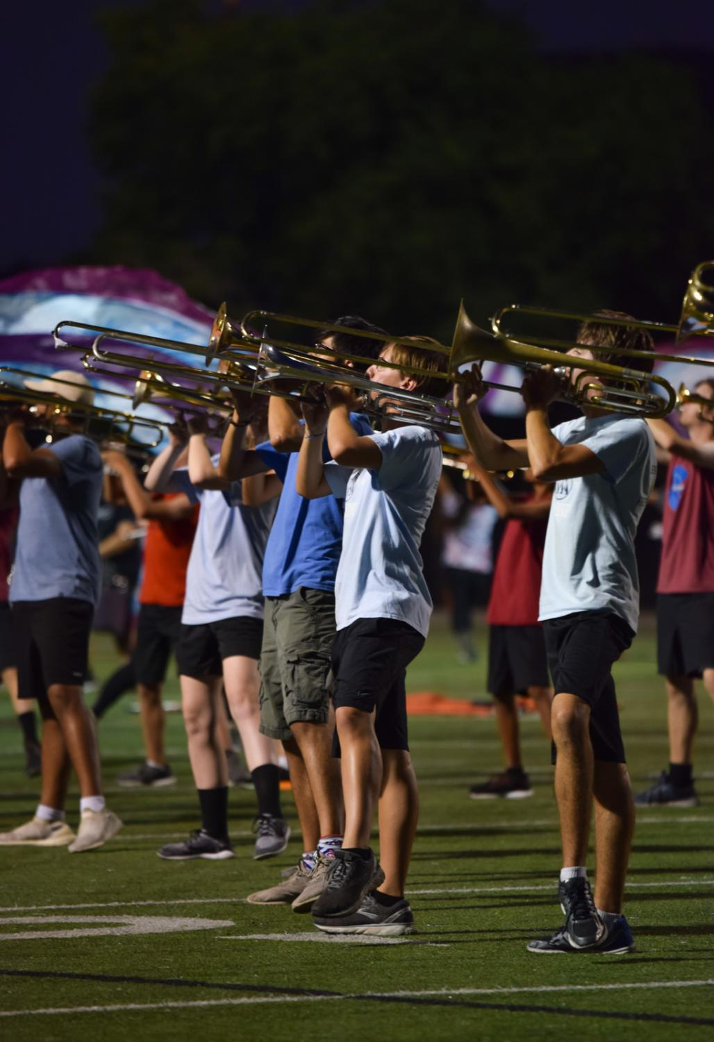 While+taking+center+field%2C+trombone+players+begin+to+lift+their+legs+for+their+choreography.