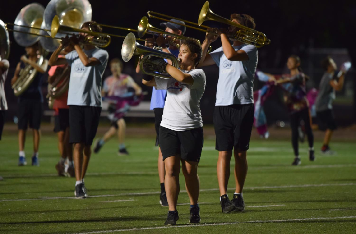 Vanessa+Henley+%E2%80%9820+plays+her+baritone+next+to+the+trombones+while+marching.