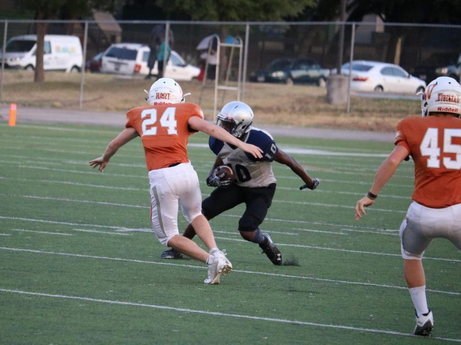 Jett Hart '22 is juked as he tries to tackle a Hendrickson receiver. Hart finished the game with one tackle.