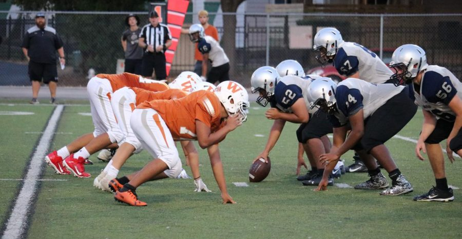 The Westwood defense lines up to oppose the Hawk offense. The defense shut the door against the Hawks, forcing four turnovers.