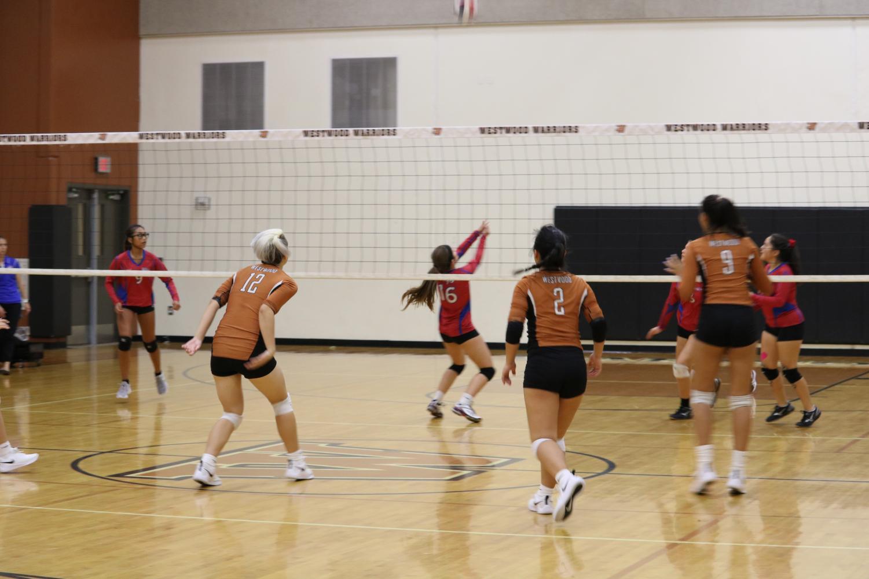 Freshmen+Kylie+Wardlow%2C+Katie+Liu%2C+and+Tanisha+Balaggan+get+ready+to+return+the+ball.+