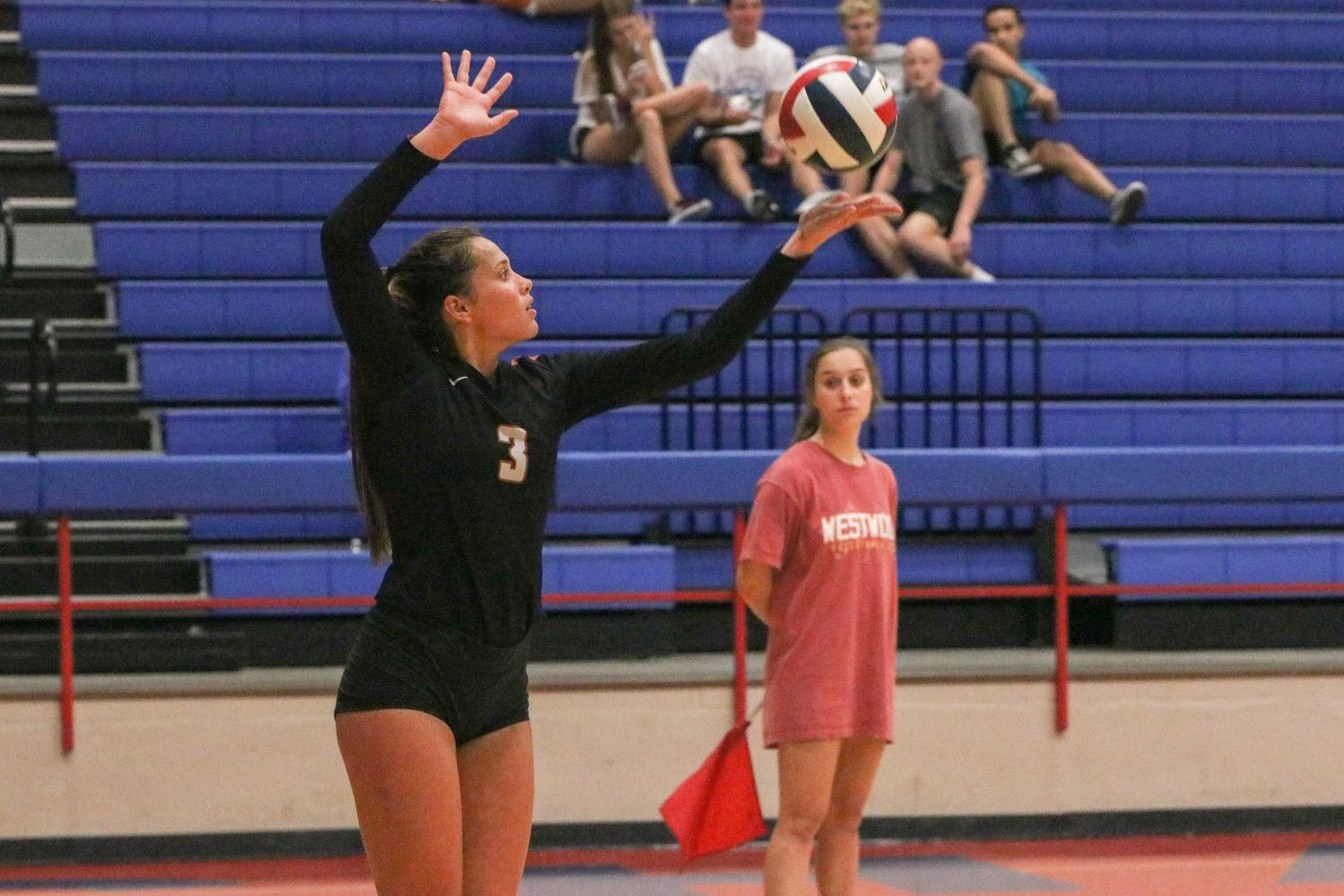 Throwing+the+ball+up%2C+Abby+Gregorczyk+%2721+serves+the+ball.+Despite+her+serve%2C+Westwood+lost+the+point.+%22Coach+Neslon+would+tell+us+where+to+serve+and+she+would+give+a+sign%2C+like+a+hand+signal%2C%22+Gregorczyk+%2721+said.