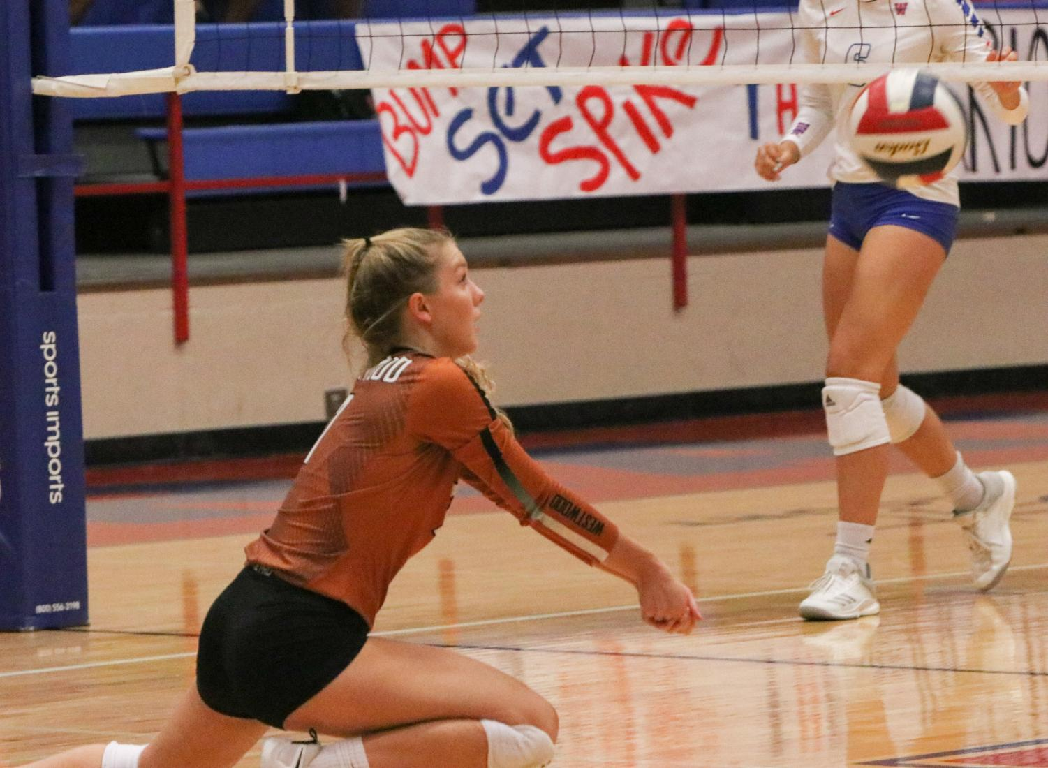 Maddie+Gillispie+%2720+slides+on+her+knees+to+pop+up+a+ball.+The+play+ended+with+Westwood+winning+the+point.
