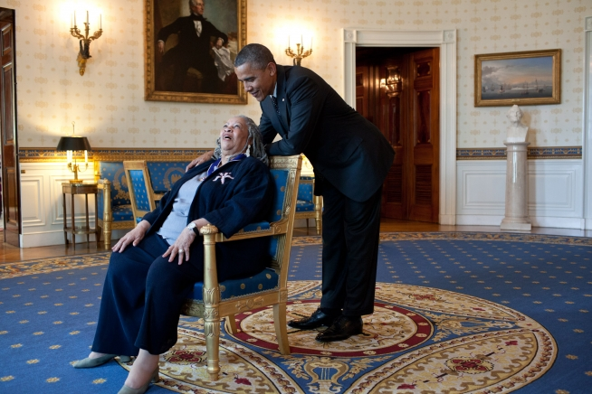 President Barack Obama and Toni Morrison laugh together in the White House.