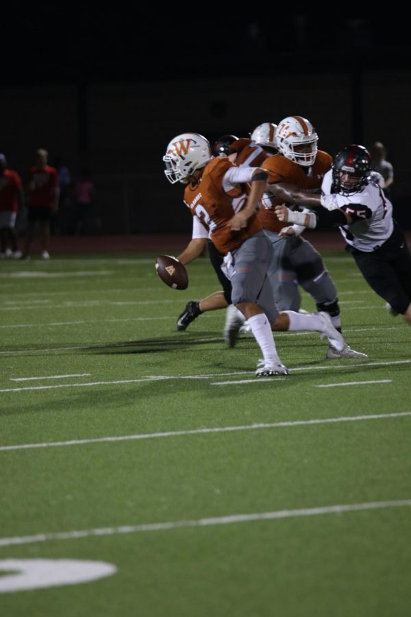 RJ Martinez 20 escapes a tackle and continues to move up the field.