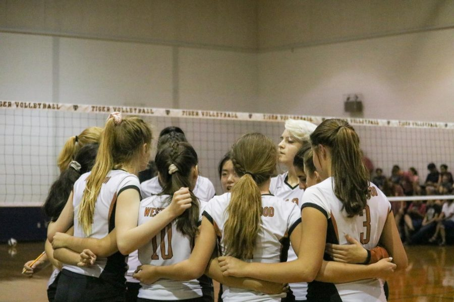 The Freshman Volleyball team huddle again. This is just before their second set, which they win.