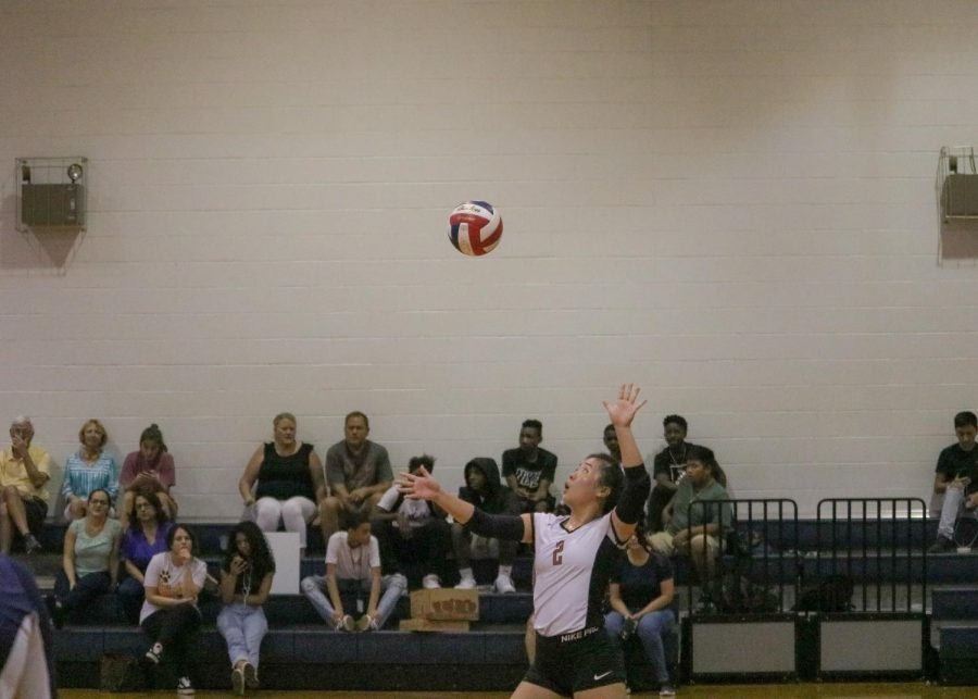 """Katie Liu '23 serving the ball. She was the first one to serve in the second set.  """"It was overall a very good game because everyone's talking, everyone's energy is up, and when our energy's up we're at our best,"""" Liu said."""