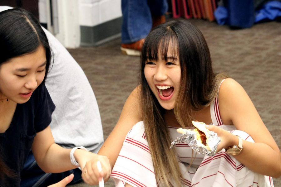 Laoise Matsumotomo '21 laughs with friends as she enjoys a breakfast taco courtesy of parent volunteers.