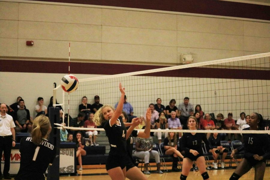 Terin Score '23 bumps the ball. Score is an outside hitter on the team.