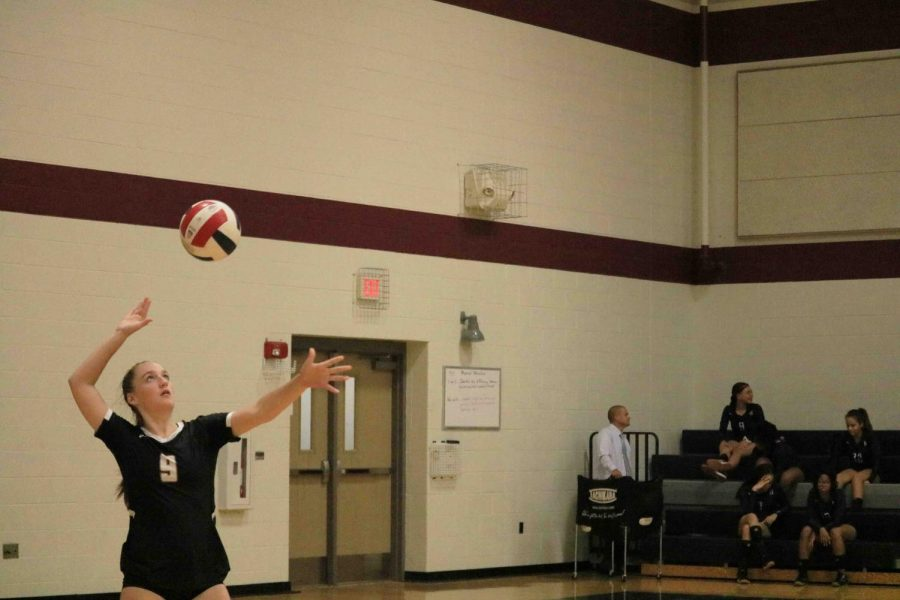 Lydia Harris '22 serves the ball. Harris served the ball four times during the second set.