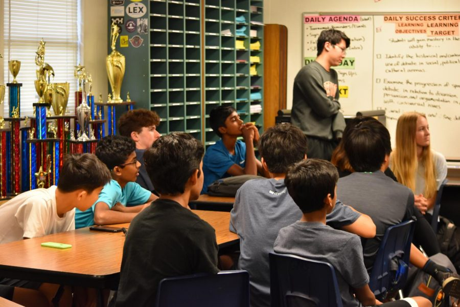 As the varsity debaters speak, new students in debate pay attention. Photo courtesy of WHS Speech and Debate.