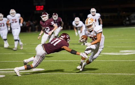 Varsity Football Notches First Win in 41-39 Thriller vs. Austin